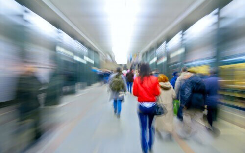 Blurred image of people rushing through a subway