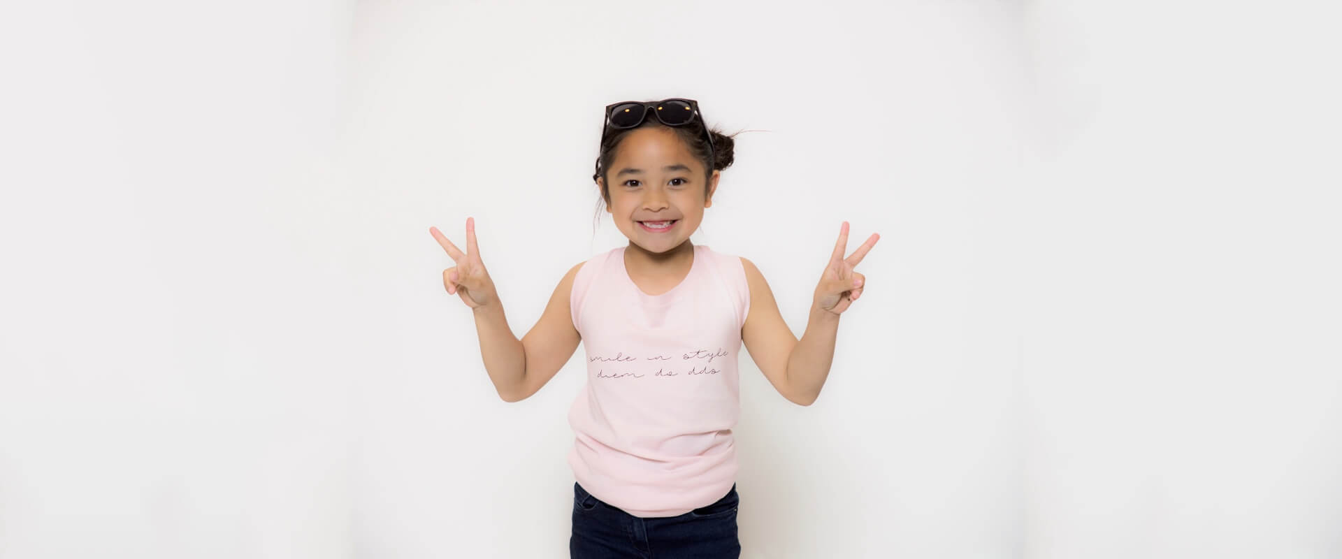 Dr. Diem Do's daughter smiling with hand gestures